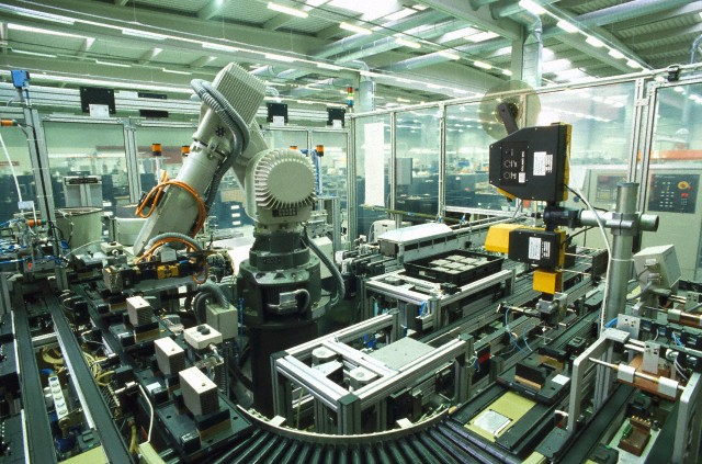 Robot assembling electronic components